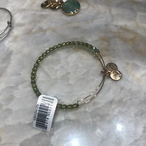 gold and green beaded alex and ani bracelet